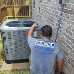 Cool Aid Air Conditioning worker inspecting an AC unit at a residence in McAllen TX