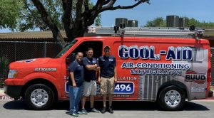 Cool Aid Air Conditioning workers standing in front of the company van